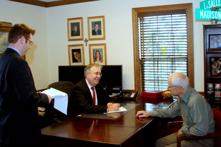 Photo of Robert Ross and Lehn Shepherd in meeting.